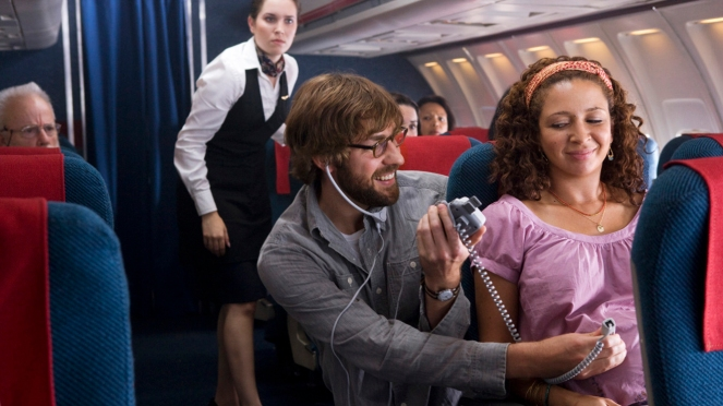 John Krasinski (left) stars as Burt and Maya Rudolph (right) stars as Verona in Sam MendesÕ AWAY WE GO, a Focus Features release. Photo: Franois Duhamel